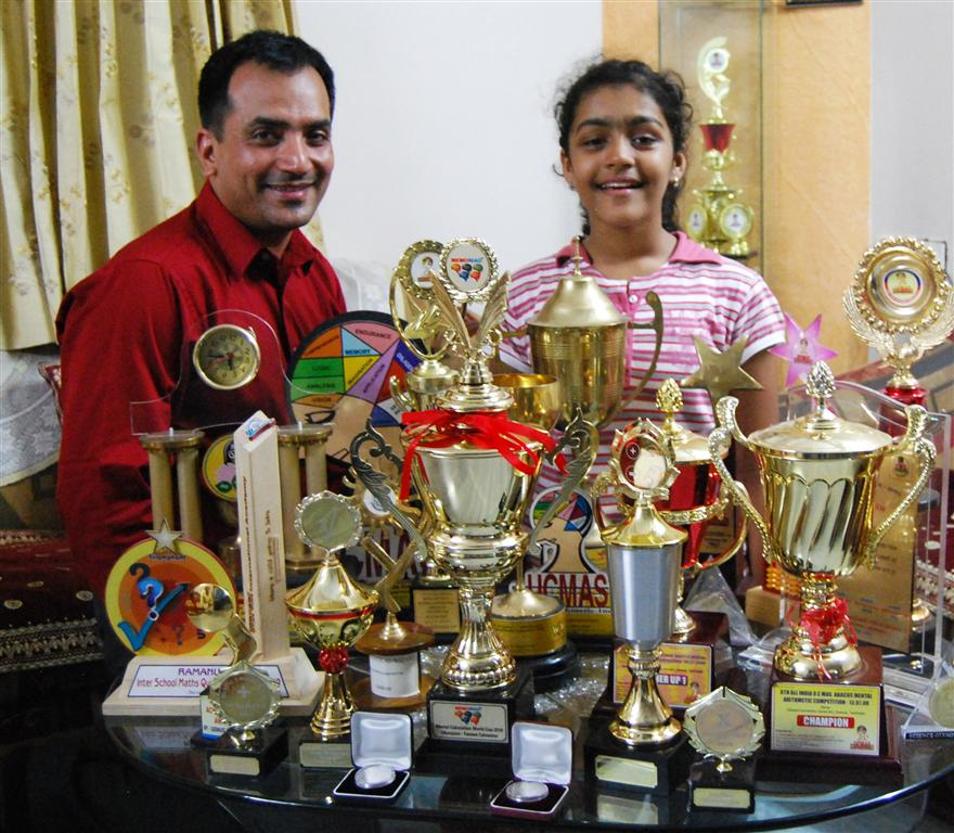 Snehal Karia with Priyanshi Somani with her trophies!